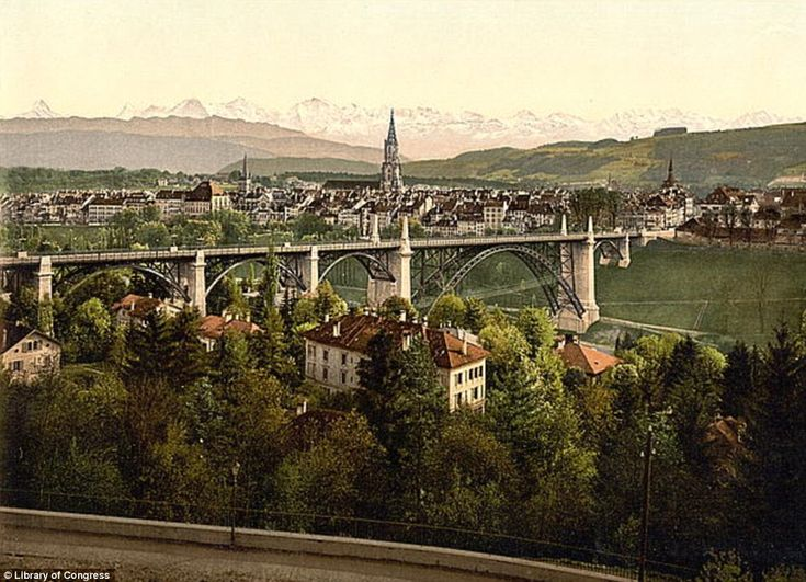 Early 1900s - The Alps rise behind Switzerland's capital city, Bern. In 2010 the city was ranked among the world¿s top ten cities for the best quality of life