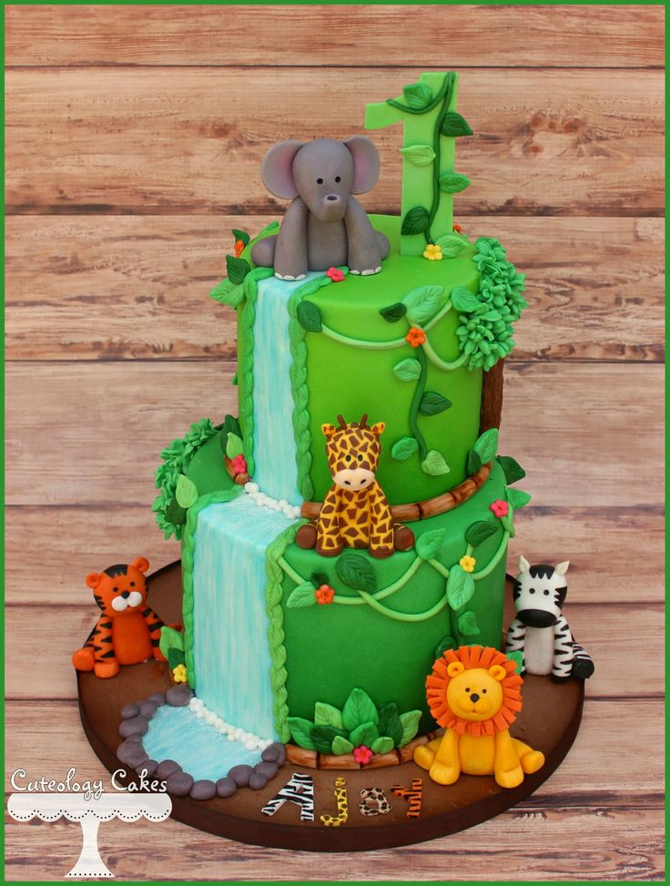 Safari themed cake for a 1st Birthday with a fondant zebra, elephant, lion, tiger and giraffe.  www.facebook.com/i.love.cuteology.cakes