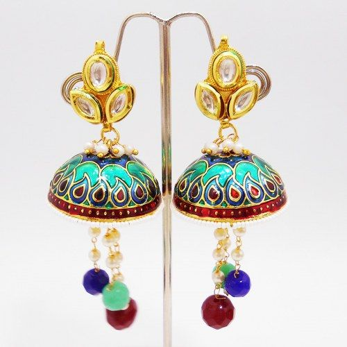 This meenakaari kundan tokri ball jhumars are made up on a hollow copper metal dome which is polished in high gold and covered up in meenakari / enameling in multiple colors. The dome is edged with moti bandhai and filled with long pearl strings, ending with cutting mutli color balls. The top part of the earring is based on a leafy enclosed kundan flower which highlights the earring.