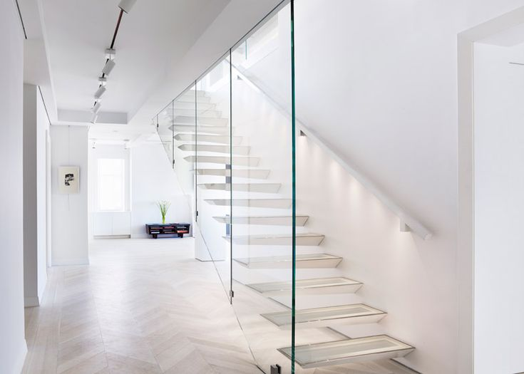 Incorporated added a cantilevered steel and glass staircase to this New York apartment.