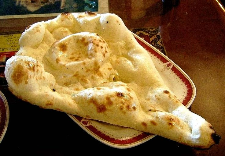 Butter naan is a delicious flat bread made in tandoor or micro oven. Learn how to make naan with our simple and easy to make steps.