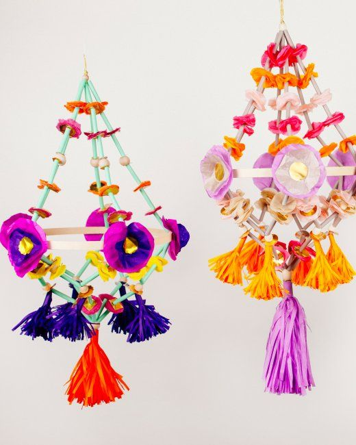 DIY Paper chandeliers, or pajaki, are a traditional Polish folk craft designed to brighten up the home with bold spring blooms during the long winter.