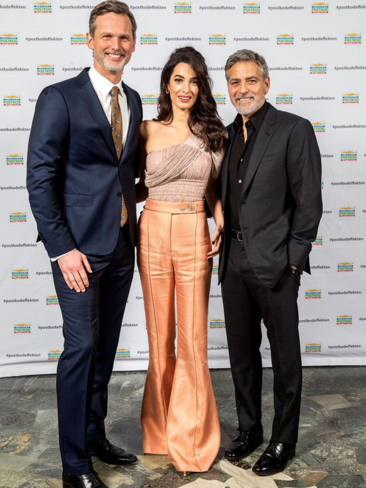 Amal and George Clooney attend the Swedish Postcode ...