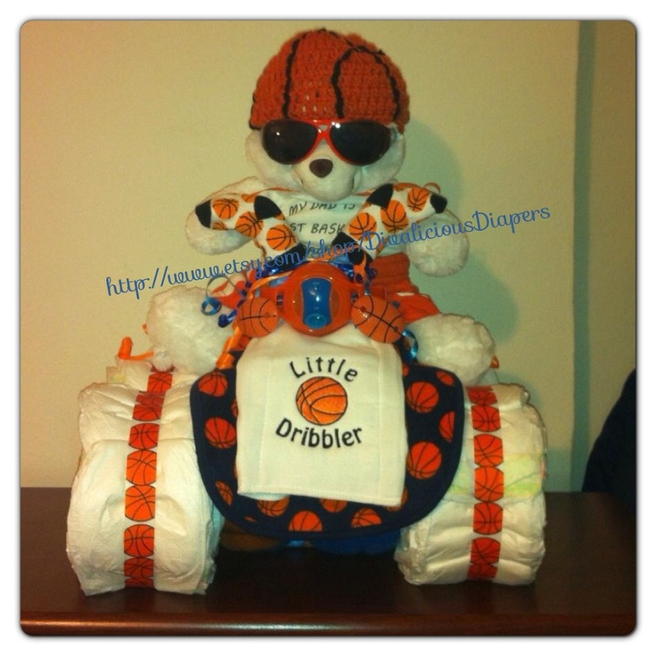 A must when I find out I'm having a boy ... Baby boy shower gift , diaper cake , 4 wheeler/ four wheeler / basketball / sports  http://www.etsy.com/shop/DivaliciousDiapers  Divalicious diaper creations on etsy  Custom made baby shower gifts, hospital gifts ,  first birthday gifts   Made to order , any theme , sport ,  nursery themes