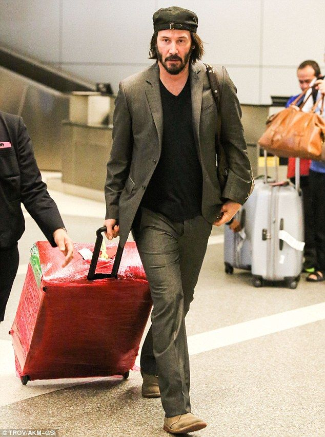 Cool traveller: Keanu Reeves was spotted at the Los Angeles International Airport on Friday
