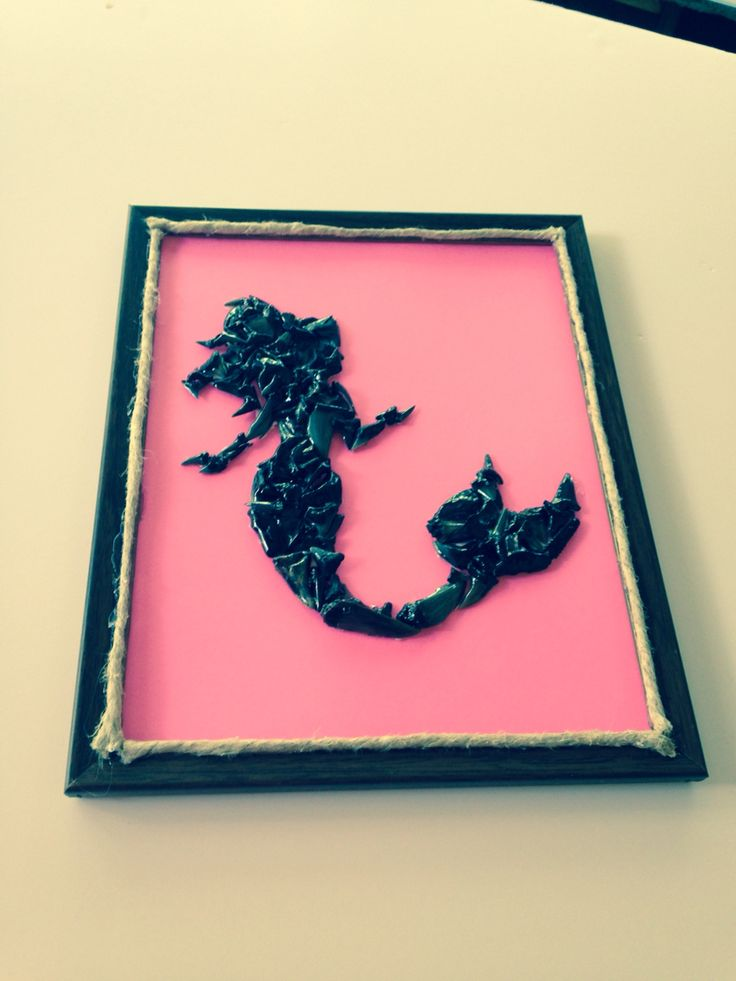Shark tooth art!!! Large mermaid made of shark teeth on pink card stock paper in a dark brown frame with rope trim! Available for purchase at www.etsy.com/shop/TwoGirlsandaBoat
