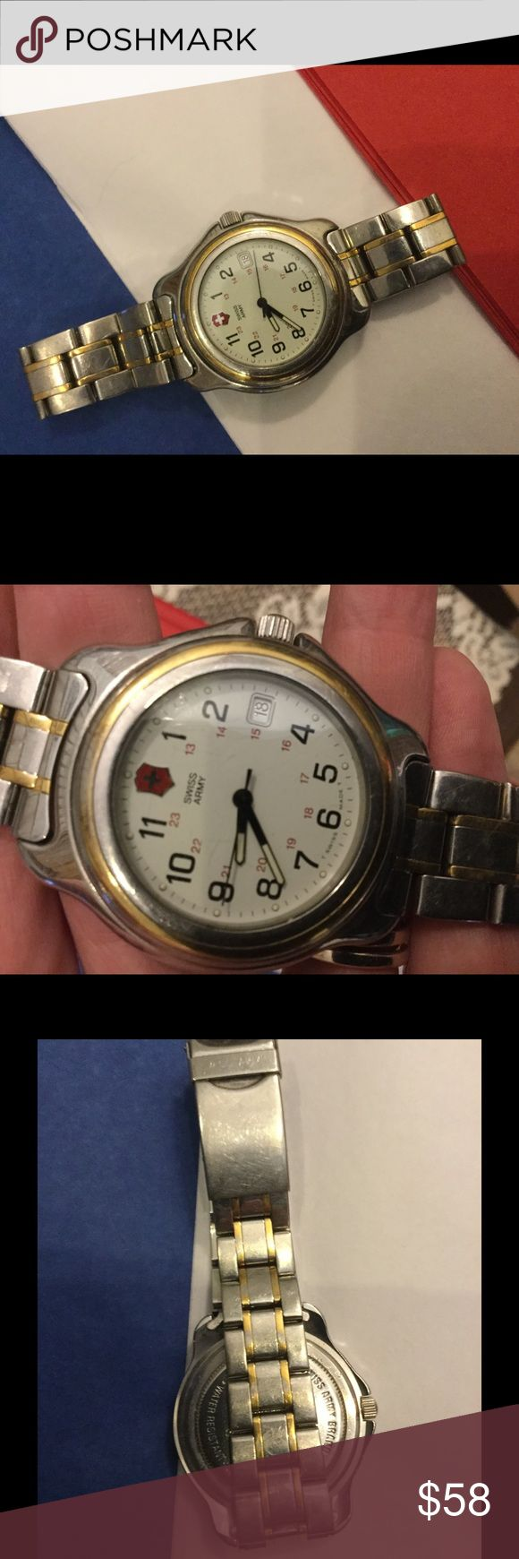 """Swiss Army watch, Swiss made, water resistant 330 Very nice men's watch, Swiss Army brand, Swiss made. Water resistant to 330 feet. Engraved on back """" Steve Johnson General Electric company 20 years"""". This watch is running fine. Great  used condition. Swiss Army Accessories Watches"""