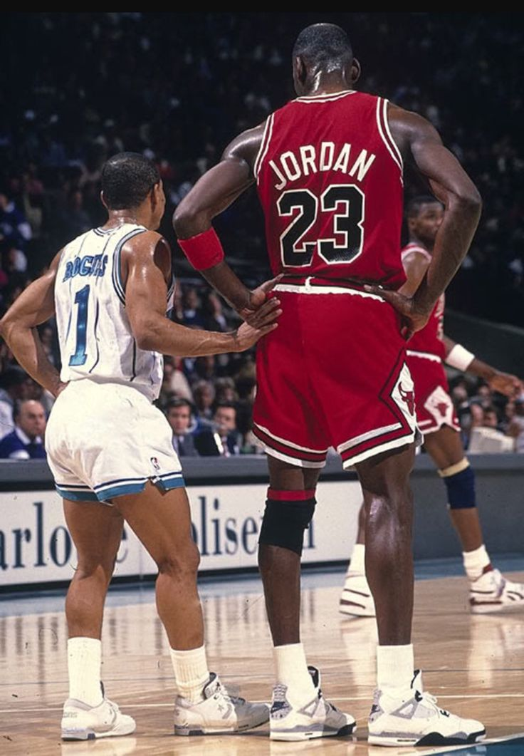 """Air Jordan IV --Colorway: White/Cement --Michael Jordan's footwear reached new heights when the """"Fire Red"""" Jordan 4 was featured in Spike Lee's classic Do the Right Thing.  Image: MJ with Charlotte Legend Mugsy Bogues.  #AirJordan #MichaelJordan #sneakers #sneakerhead #basketballshoes #AirJordanIV"""