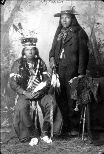 Nez Perce men (including Joe Craig) in formal portrait, Idaho Photographer: Cummings, E. G.