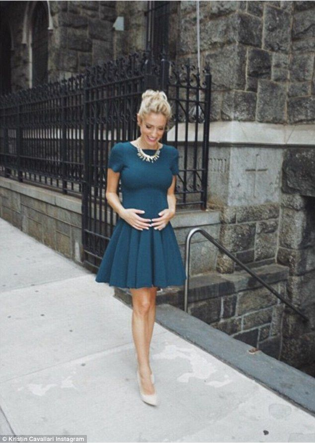 Pregnant pause! Kristin Cavallari shares snap of herself holding her bump while on a break...