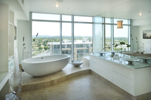 Imagine lighting some scented candles and relaxing in a $4,000 bathtub sipping your peanut noir while perverts in the condo next to you ogle your naked ass.  Is that going to happen?  No.