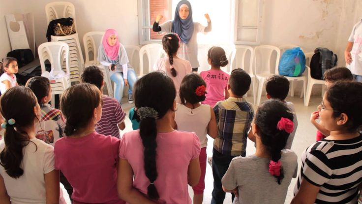 "Syrian children in Lebanon perform songs they had written which included their messages to commemorate World Refugee Day. The lyrics sung here are thanking Lebanon for being a host country to Syrian refugees:  ""Two thanks to humanity, Two thanks to humanity, Thanks to every human, thank you thank you Lebanon"""
