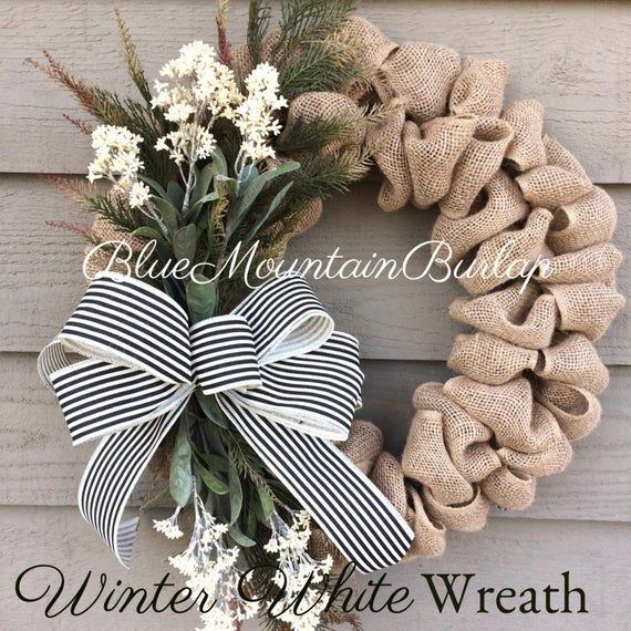 The White Flowers Burlap Wreath Accented With Faux Pine Greenery Flowers And Completed With A Beautiful Strip Burlap Wreath Diy Burlap Wreath Door Wreaths Diy