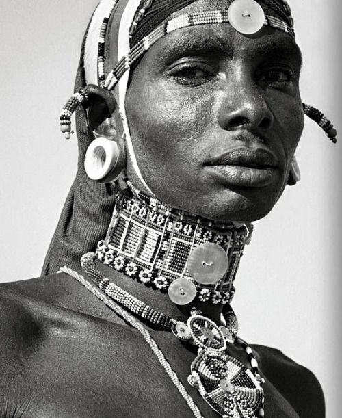 Samburu man, Kenya   Photo © Peter Gasser