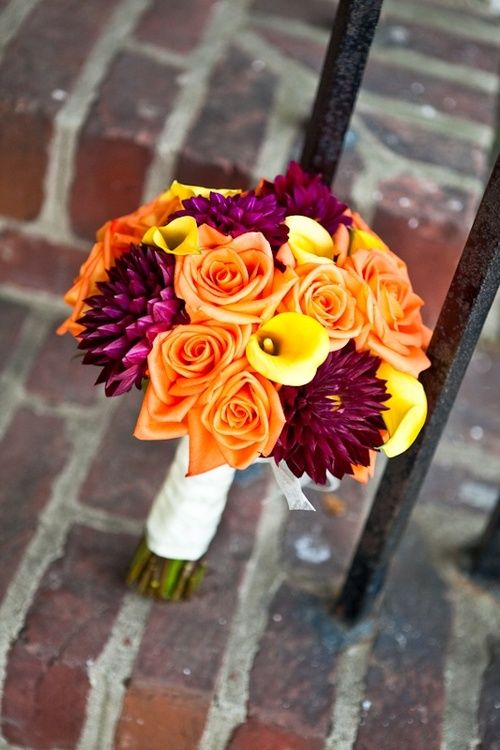 Purple and orange wedding bouquet--love the touches of yellow/gold