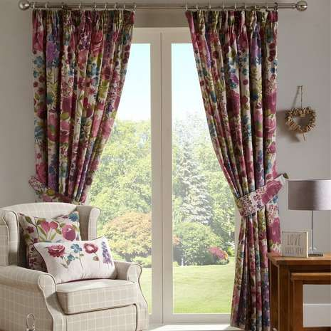 Fully lined with a pencil pleat header, these ready made curtains feature a bold floral pattern in shades of pink, blue, green and purple on a natural backgroun...