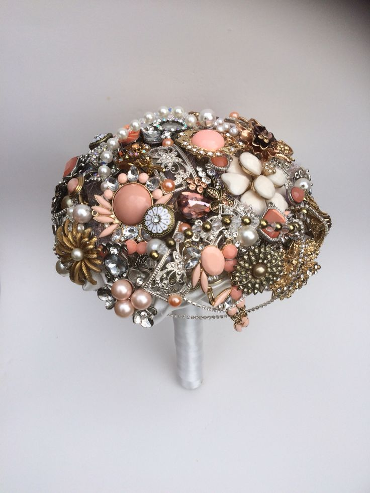 Coral and peach jewel brooch bouquet from www.floriodesigns.uk