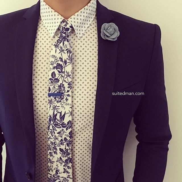 Love that @Suited_Man style with their wide selection of floral ties and lapel pins | Get them now at www.suitedman.com | Follow @suited_man #suitup @SuitedManStyle