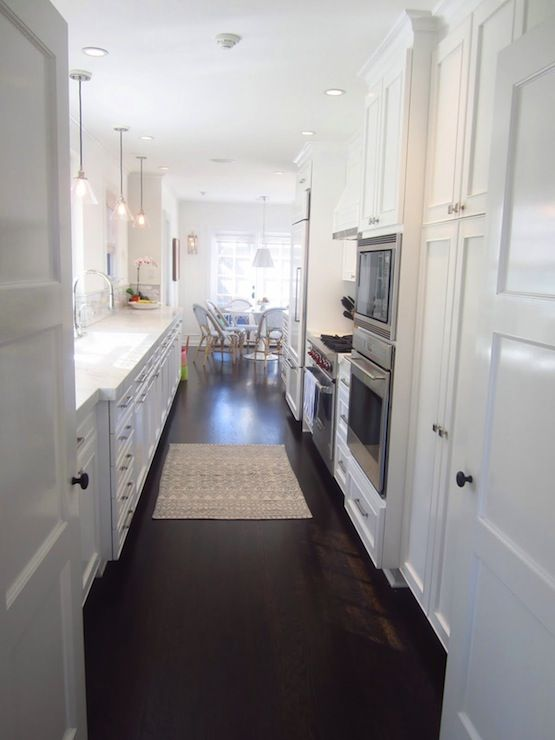COCOCOZY: Tom Newman Architect - Stunning view of chic white galley kitchen from double entry ...