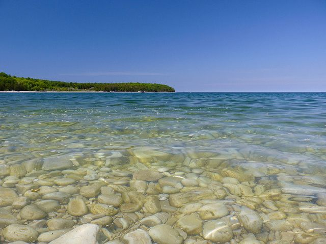 The secluded Pebble Beach, located between Ephraim and Sister Bay on the Bay side of the Door Peninsula is a unique spot. The shoreline drops off like a deep bowl and yes, it is all pebbles!