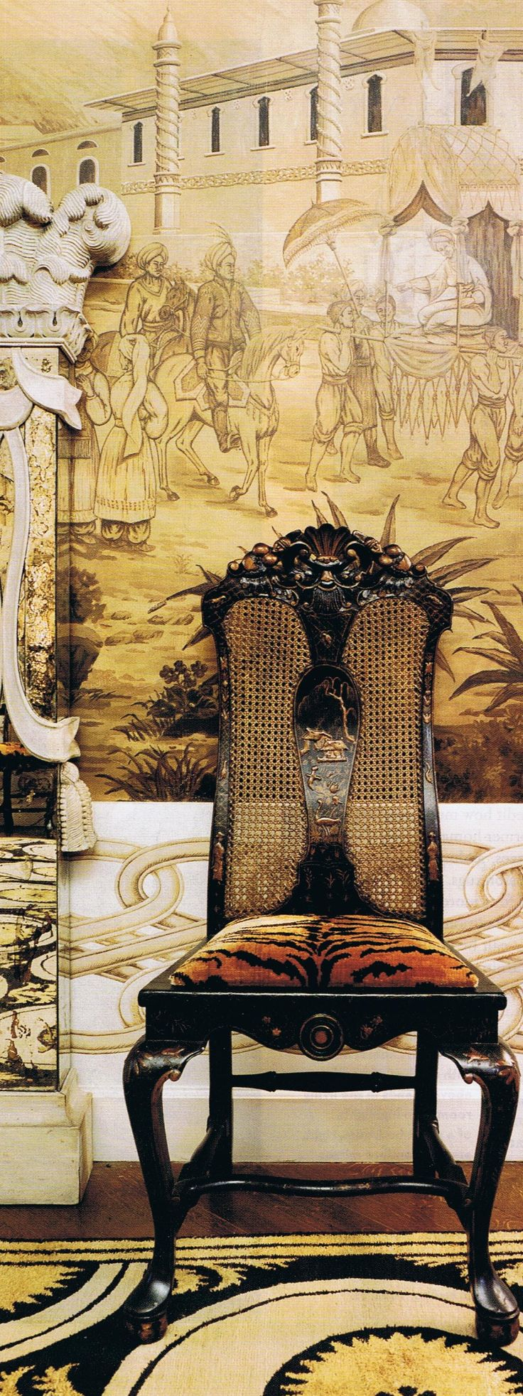Infusion of sepia tones - Black chair with caning and animal print upholstery
