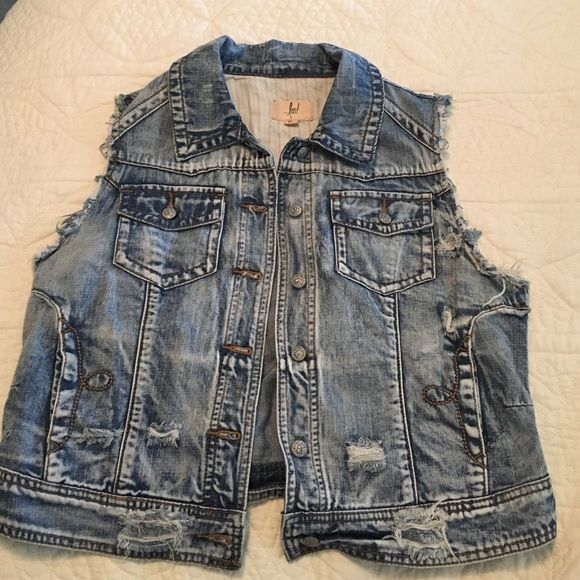 NWOT Destructed Sleeveless Jean Jacket Bought this for Vegas but never wore it. It's like new, purchased with the holes in it as an aesthetic. Looks really cute, especially paired with dresses! Lost Jackets & Coats Jean Jackets