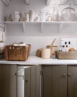"""Laundry Rooms — Providence Design """"The beadboard backsplash looks clean and fresh and I love the paneled detail on the cabinet doors. Notice they hide the washer and dryer."""""""