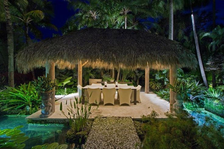 Craig Reynolds pulled together a dining area under a tiki hut, a koi pond and a bridge made from oolite and coral stone to create a tropical garden oasis.
