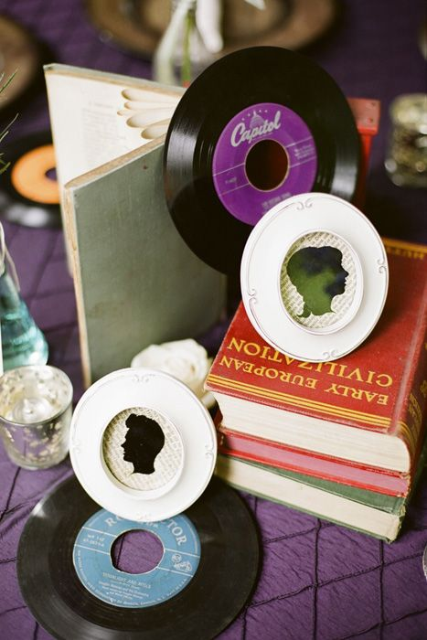 Vintage books and records centerpiece Photo Source: CJ's off the Square  #vintageweddings #vintagebooks #vintagerecords #vintagecenterpiece