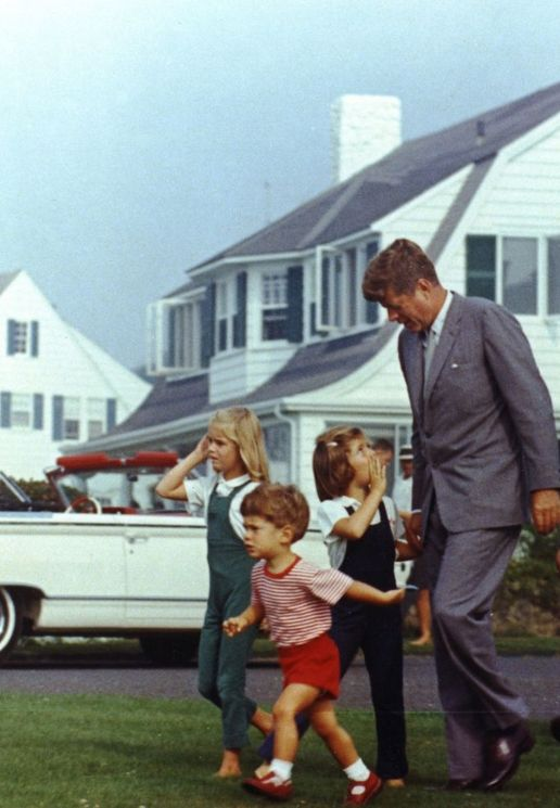 President John F. Kennedy with his children, John Jr. and Caroline, and a cousin, on the way to a candy store in Hyannis Port, 1963