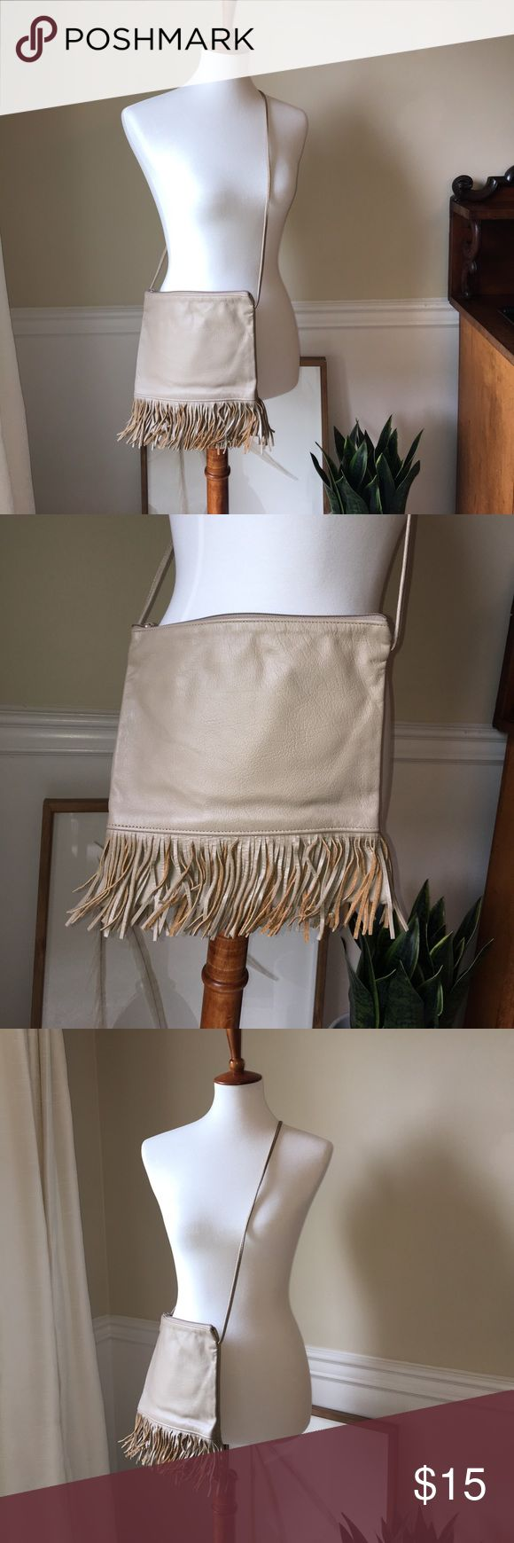 Real leather cross body bag with fringe This tan/ taupe bag is the perfect size for any music festival! It's real leather, has amazing fringe all around the bottom of the bag AND zips shut! The strap is knotted to make it shorter but you can have it untied as well. Happy shopping! no tag Bags Crossbody Bags