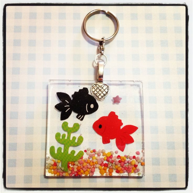 A red and black koi in a square shaped 'aquarium'. The keychain can be used to hang all your keys from!     Colourful candy sprinkles used as the 'gravel' in the aquarium is also embedded in the resin, and this keychain is approx. 5cm wide and 5cm in length, and 0.5cm thick.    Given the preservi...