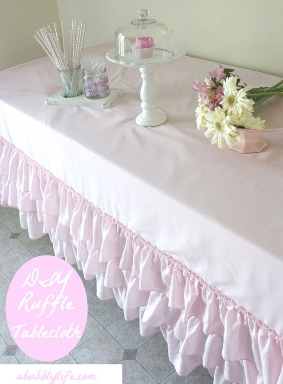 DIY no sew ruffled table cloth, using ruffled thrift store sheets/bed skirts and washable fabric glue. Who would have thought?!