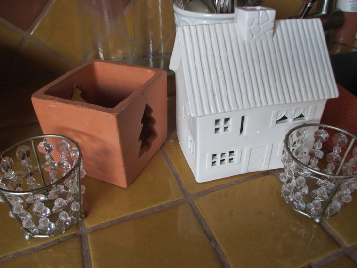 Holiday lights, ceramic house, terra cotta tree and crystal candle holders, SuddenlySeen