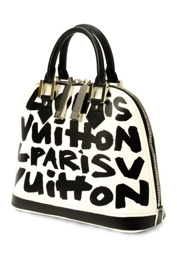Louis Vuitton Alma Handbag.  I am not usually one to pine for a Louis but I LOVE this one!