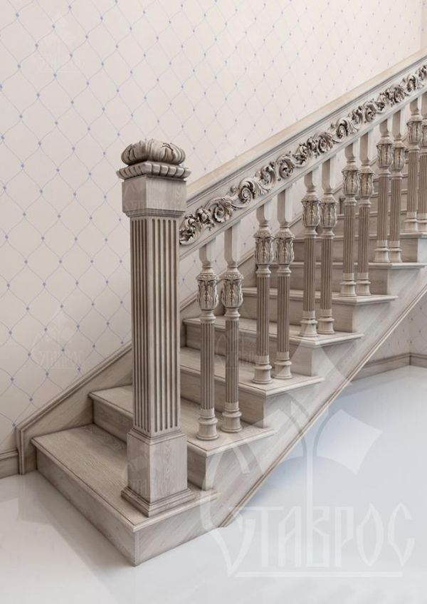 Laconic combination of carved decoration and color of wood finishes (bleached oak) in the design of a flight of stairs.