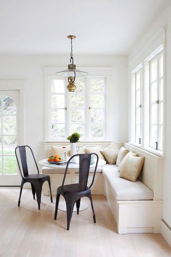 Breakfast nook in white kitchen.