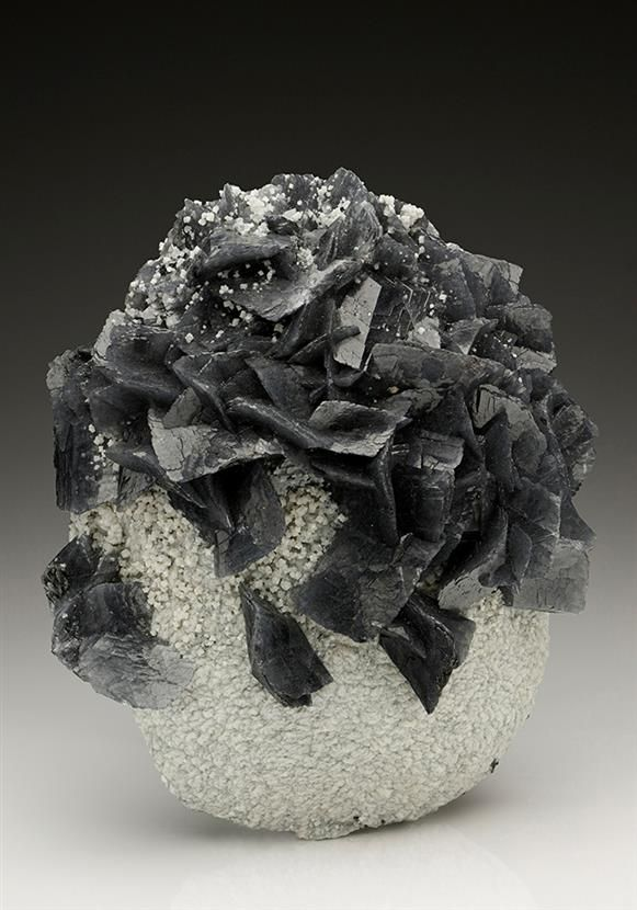 Calcite included by Boulangerite from the Herja Mine, Romania. Crystal Classics Minerals