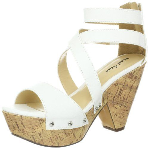 Lucy wears white wedge sandals as her footwear of choice.