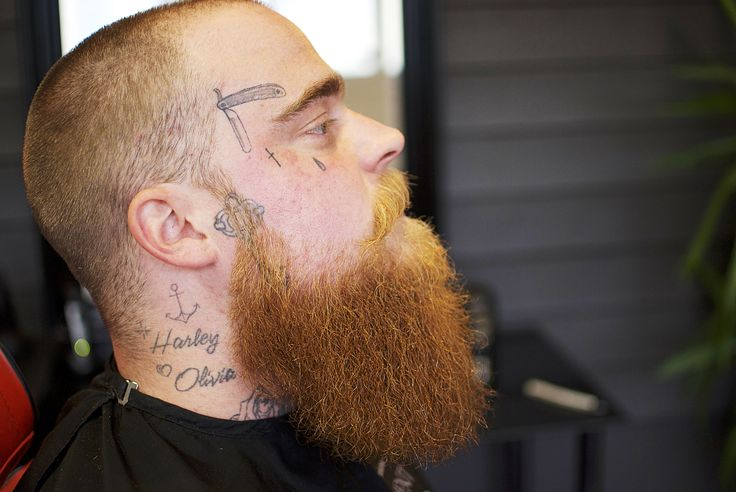 Great ginger side beard on a tattooed face. Awsome! Beard trim by barber Mohammad Alasmar at the barbershop Royal Treatment in Ängelholm, Sweden.  For more great beards follow @royaltreatmentbarber on Instagram