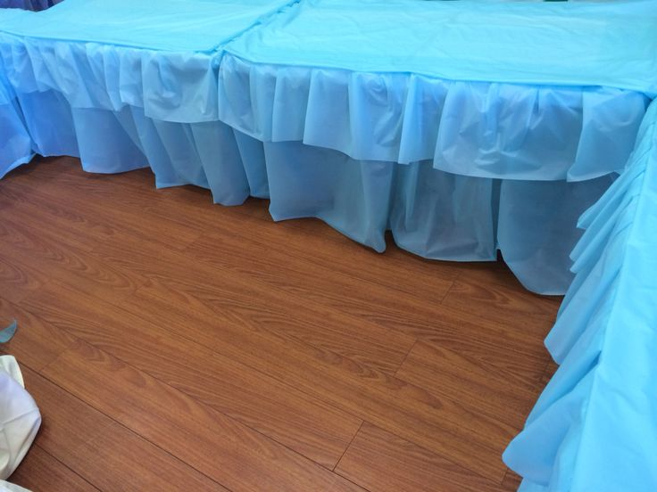 Gorgeous and very simple table skirt and covering using a role of plastic table cloth.
