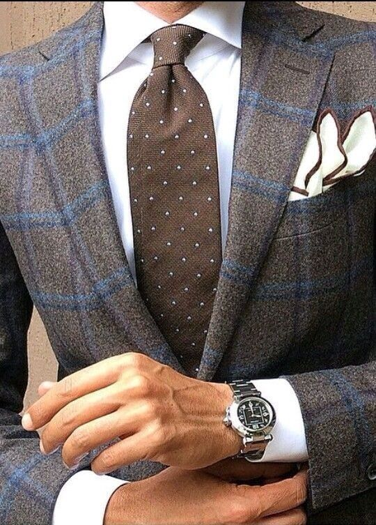 Blue and brown windowpane suit, white shirt, brown dotted tie, white tipped p square