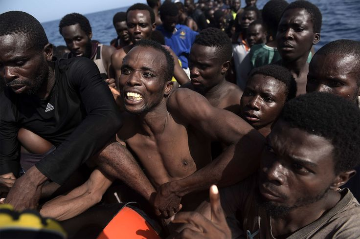 Chilling photographs show a desperate journey across the Mediterranean.