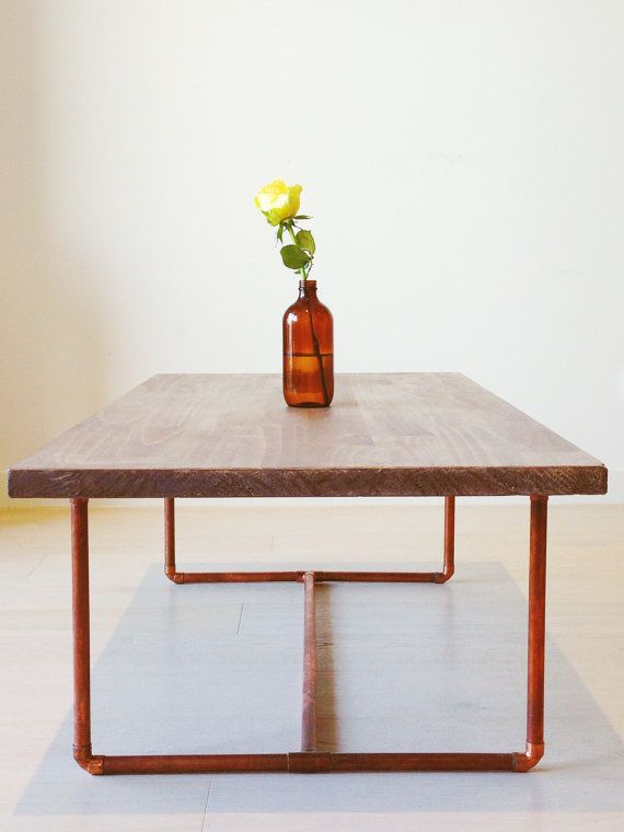 Lightly stained and lightly varnished pine table top to provide a degree of protection without giving it an overly glossy look. A sturdy copper