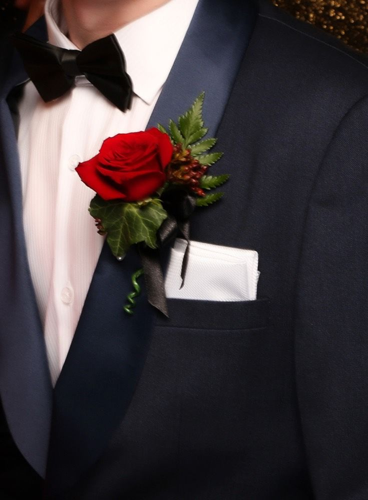 Massey Ball 2015. Love this Navy suit paired with a white pocket square and red rose, so dapper! www.whitedoor.co.nz