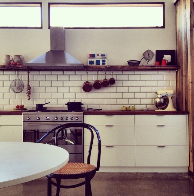 white cabinets, wood countertops, subway tile, dark grout, open shelves, clerestory windows