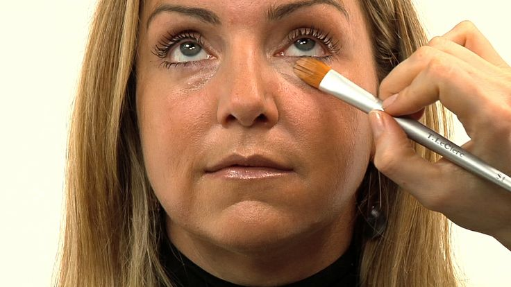 Nothing makes you look older and more tired than dark circles under your eyes. Professional makeup artist Vinnetta Scrivo shows you how to conceal them.