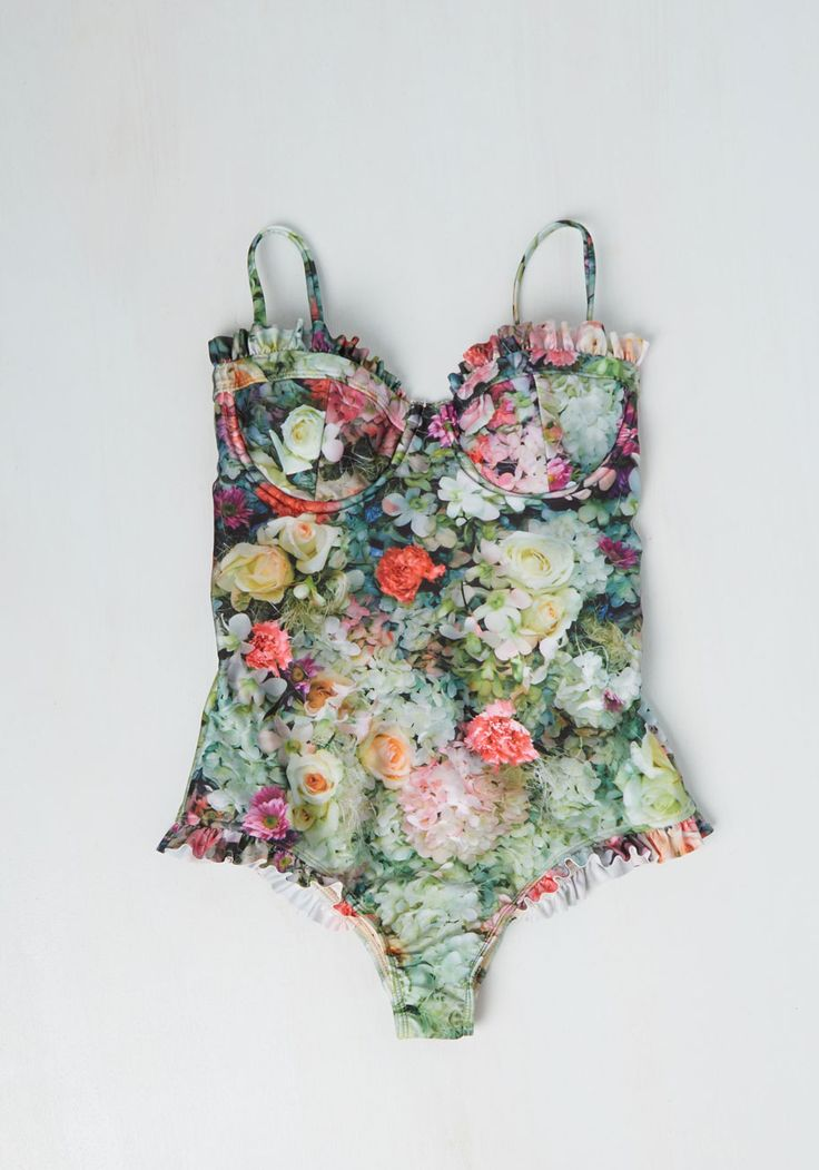 A Rose by Any Other Fame One-Piece Swimsuit. Soak up the sun in this floral one piece by Wildfox and youll be the star of the sea! #green #modcloth