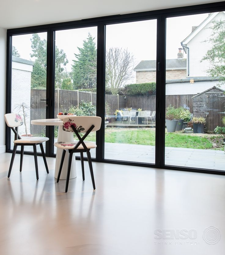 Uniting the inside and outside - these huge sliding doors really open the space and reflect light onto the resin flooring.