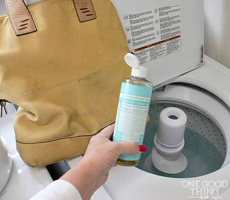 DIY - leather bag + washing machine = clean  Completely clean out your bag.   Pour about 1/4 cup castile soap into the washing machine, drop in bag, set washer to GENTLE CYCLE (or hand wash cycle…something along those lines), and turn it on. Dry on low in dryer, add big towels, or dry in the sun.  Try on a well worn, extremely in need bag first!